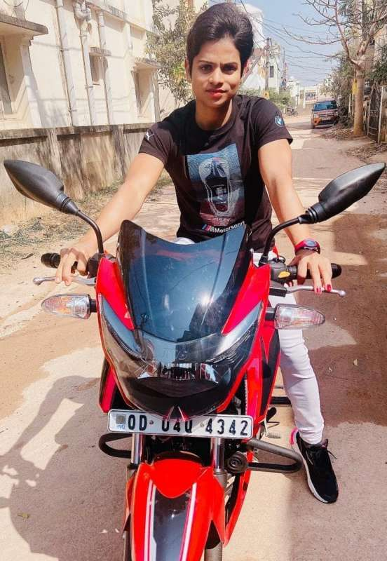 Dutee Chand with her TVS Apache RTR